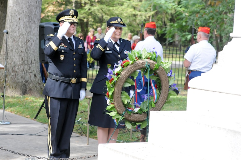 Brigadier Gen. Stephen E. Strand, left, deputy chief of engineers (Reserve affairs), and Chap. (Maj.) Dawn Siebold, 88th Regional Support Command chaplain, salute the wreath they placed at the tomb of former President Rutherford B. Hayes during a ceremony honoring the 19th president of the United States in Fremont, Ohio, October 8, 2017.