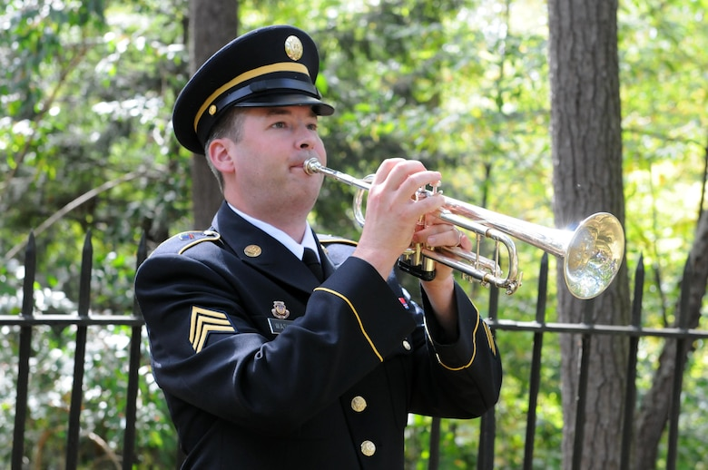 Sergeant Luke Washburn, a bugler with the 338th Army Band of the 88th Regional Support Command, plays Taps on the bugle during a wreath laying ceremony honoring former President Rutherford B. Hayes in Fremont, Ohio October 8, 2017.