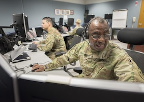 Soldiers at consoles conduct a missile defense exercise.