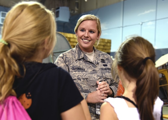 Staff Sgt. Tatiana Cookingham of the 117th Maintenance Squadron talks to young women during the Women in Aviation event at the Southern Museum of Flight
