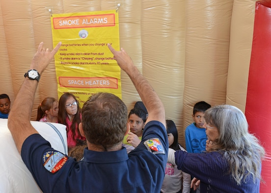 Edwards Air Force Base Fire Department personnel visit students at Branch Elementary at Edwards AFB.