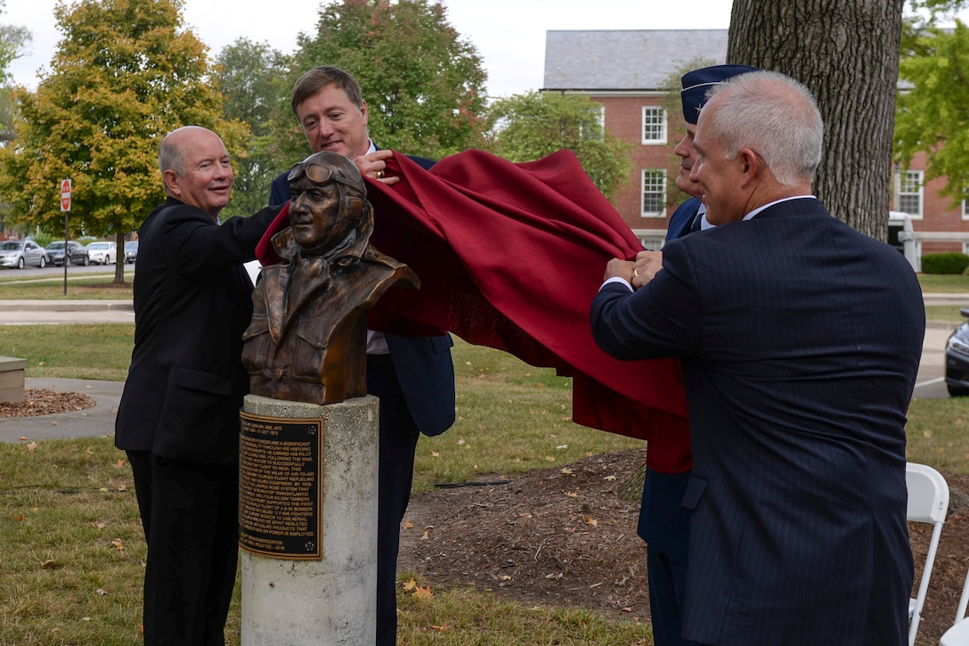 Guest speakers for Sir Alan Cobham's Air Mobility Command Walk of Fame induction ceremony unveil his memorial, Oct. 5, 2017, at Scott Air Force Base, Ill.