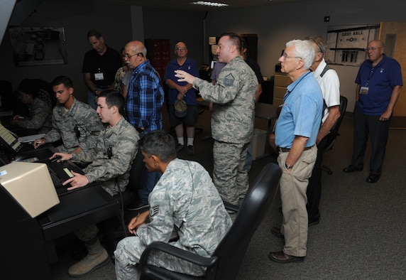 "Master Sgt. Gary Cozzetti, 334th Training Squadron instructor, provides a tour inside the air traffic control radar simulator at Cody Hall during the U.S. Air Force Flight Checkers Association tour Oct. 10, 2017, on Keesler Air Force Base, Mississippi. The association's mission is ""to honor and perpetuate the memory of all who served in the USAF Facility Checking Units in peace and war."" During their visit to Keesler they also viewed an aircraft static display and received a windshield tour of the base. (U.S. Air Force photo by Kemberly Groue)"