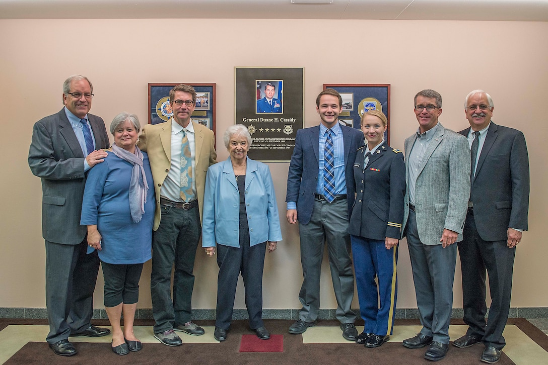 Members of the Cassidy family gather in front of a display honoring Gen. Duane H. Cassidy prior to a dedication ceremony renaming the Global Reach and Planning Center to the Gen. Duane H. Cassidy Conference Center, at Scott Air Force Base, Ill., Oct. 6, 2017.