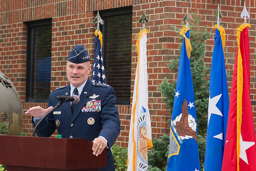 Gen. Carlton D. Everhart II, Air Mobility Command commander, describes Gen. Duane H. Cassidy's legacy during a dedication ceremony renaming the Global Reach and Planning Center to the Gen. Duane H. Cassidy Conference Center, at Scott Air Force Base, Ill.
