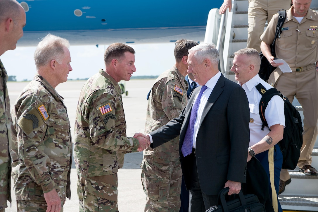 Defense Secretary Jim Mattis and the senior enlisted advisor to the chairman of the Joint Chiefs of Staff shake hands with service members.
