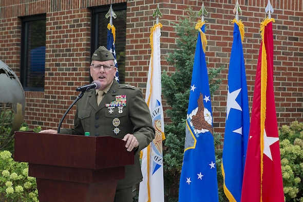 Marine Lt. Gen. John J. Broadmeadow, U.S. Transportation Command deputy commander, discusses Gen. Duane H. Cassidy's impact of USTRANSCOM during a dedication ceremony renaming the Global Reach and Planning Center to the Gen. Duane H. Cassidy Conference Center, at Scott Air Force Base, Ill., Oct. 6, 2017.