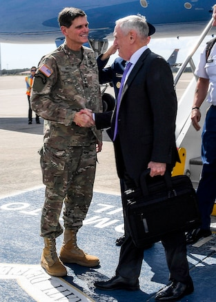 U.S. Secretary of Defense James Mattis is greeted by U.S. Army Gen Joseph L. Votel, commander, U.S. Central Command, at MacDill Air Force Base, Fla., October 11, 2017. While at MacDill, the secretary will  meet with leadership at U.S. Central Command and U.S. Special Operations Command to discuss support to global operations. (Department of Defense photo by U.S. Air Force Tech Sgt. Dana Flamer)