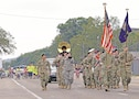 """The 1st Infantry Division Band led the annual """"Ogfest"""" parade down Main Street in Ogden, Kansas, Sept. 16. The community gathered to cheer on participants while the band played."""