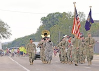 "The 1st Infantry Division Band led the annual ""Ogfest"" parade down Main Street in Ogden, Kansas, Sept. 16. The community gathered to cheer on participants while the band played."
