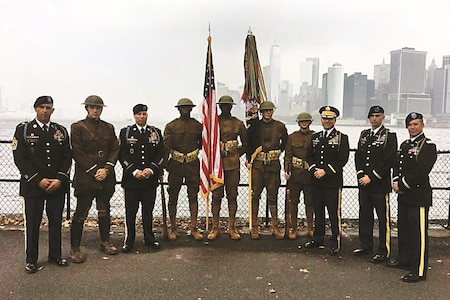 "Soldiers with the 1st Battalion, 16th Infantry Regiment, 1st Armored Brigade Combat Team, 1st Infantry Division, pose on Governors Island, New York Harbor, Sept. 16 during WWI History Weekend on the island. The event, which took place Sept. 16 to 17, honored the centennial of the U.S. entry into World War I. The ""Iron Rangers,"" who were stationed on the island from 1922 to 1942, presented the colors and paid homage to their heritage over the weekend."