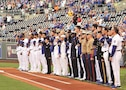 """Soldiers with the """"Big Red One"""" joined service members from the U.S. Army's fellow branches for the Kansas City Royals' Armed Forces Night at Kauffman Stadium in Kansas City, Missouri, Sept. 11. The 1st Infantry Division Soldiers presented the colors before the game and joined fellow service members on the field.  """"As a baseball fan… I'm 34 years old, and when I was out there I felt like I was 14 again,"""" said Sgt. 1st Class Daniel Coelho, 1st Battalion, 16th Infantry Regiment, 1st Armored Brigade Combat Team, 1st Inf. Div., one of the Soldiers participating."""