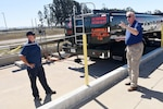 Tracy Taylor, Defense Logistics Agency Energy instructor, trains Jerry Woiton, 30th Logistics Readiness Squadron contractor during a fuel spill exercise, Oct. 6, 2017, at Vandenberg Air Force Base, Calif. DLA Energy provides military installations with the training necessary to prevent and react to disasters, such as this simulated fuel spill, while adhering to federal regulations. (U.S. Air Force photo by Tech. Sgt. Jim Araos/Released)