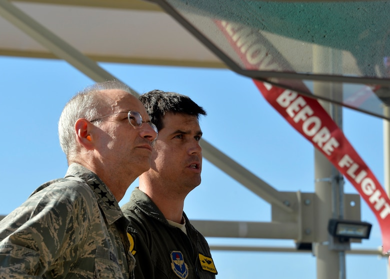 Maj. John Omohundro, 61st Fighter Squadron pilot, shows Lt. Gen. Mark Ediger, Headquarters U.S. Air Force Surgeon General, the F-35A Lightning II during a site visit at Luke Air Force Base, Ariz., Oct. 11, 2017. Ediger visited Luke to see the new renovations to the 56th MDG and how they support the F-35A Lightning II mission. (U.S. Air Force photo by Senior Airman Devante Williams)