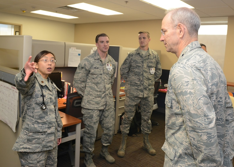 Lt. Gen. Mark Ediger, Headquarters U.S. Air Force Surgeon General, is briefed by Maj. Priscilla Wong, 56th Medical Group allergist, while touring the 56th MDG facility during a site visit at Luke Air Force Base, Ariz., Oct. 11, 2017. Ediger visited Luke to see the new renovations to the 56th MDG and how they support the F-35A Lightning II mission. (U.S. Air Force photo by Senior Airman James Hensley)