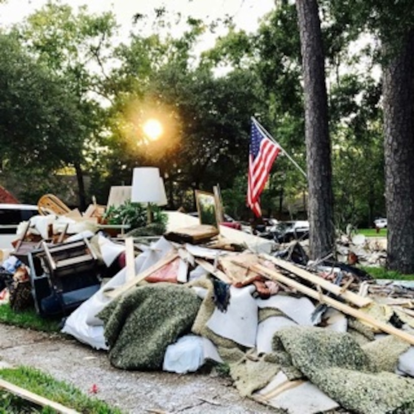 Piles of debris sit outside a residential home in Friendswood, Texas.(Courtesy Photo)