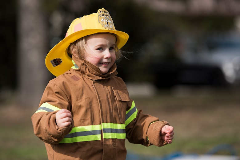 "A child from the Kaiserslautern Military Community runs a child fireman's course during the Fire Prevention Week open house on Ramstein Air Base, Germany, Oct. 7, 2017. The course included a fire hose drag, litter carry and forcible entry challenges. Fire Departments from Ramstein Village, Landstuhl, Carlsberg, and Technical Relief Foundation (THW) Kaiserslautern, participated in the parade and open house. This year's theme, ""Every second counts, plan two ways out!"" encourages families to have more than one exit plan in case of an emergency. (U.S. Air Force photo by Airman 1st Class Devin M. Rumbaugh)"