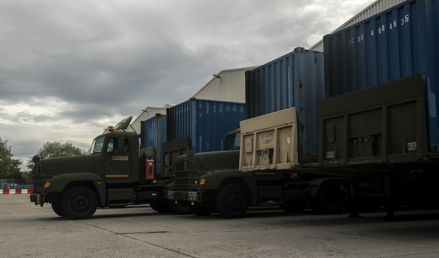 U.S. Army trucks wait to be loaded with mail for servicemembers stationed within the European theater in Frankfurt, Germany, Oct. 5, 2017. The U.S. Air Forces in Europe and Air Forces Africa Air Postal Squadron works alongside the Army to provide air and ground transportation for mail delivered throughout Europe. (U.S. Air Force photo by Senior Airman Tryphena Mayhugh)