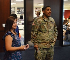 Army Sgt. 1st Class Jaime Guerra, right, a recruiter at Arrowhead Recruiting Center, and his wife, Mayra, smile as they watch their son Anthony (not pictured) perform the Army oath of enlistment at Phoenix Military Entrance Processing Station, Sept. 21, 2017. Army photo by Alun Thomas