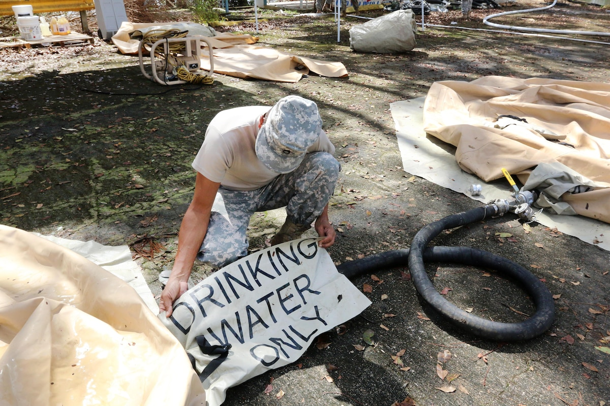 An Army Reserve soldier sets up a tactical water purification system in Quebradillas.