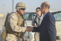 U.S. Marine Brig. Gen. Roger Turner, left, the commanding general of Task Force Southwest, greets Ambassador Hugo Llorens, right, the Special Chargé d'Affaires of the U.S. Embassy in Kabul, at Bastion Airfield, Afghanistan, Oct. 12, 2017. Llorens met with Task Force Southwest Marines and key Afghan National Defense and Security Force leaders to discuss recent progress and challenges in the fight against the Taliban in Helmand province. (U.S. Marine Corps photo by Sgt. Lucas Hopkins)