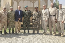 Ambassador Hugo Llorens, third from left, the Special Chargé d'Affaires of the U.S. Embassy in Kabul, U.S. Marines with Task Force Southwest and Afghan National Defense and Security Force leadership pose for a photo at Camp Shorab, Afghanistan, Oct. 12, 2017. During his visit, Llorens had an opportunity to discuss mission progress with key Task Force Southwest and ANDSF leaders, while reaffirming the United States' commitment to thwarting the Taliban in Helmand province. (U.S. Marine Corps photo by Sgt. Lucas Hopkins)