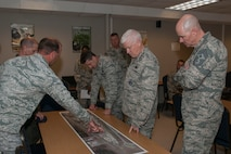 187th Civil Engineering Squadron Commander Capt. Adam Sanders briefs Lt. Gen. Rice and Chief Master Sgt. Anderson.