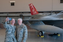 Lt. Gen. Rice and Chief Master Sgt. Anderson take a selfie with a Redtail F-16.