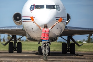 Airmen unload food and water supplies from a 727 commercial airliner at Rafael Hernandez Airport, Aguadilla, Puerto Rico, Oct. 9, 2017. Photos by Army Staff Sgt. Pablo N. Piedra