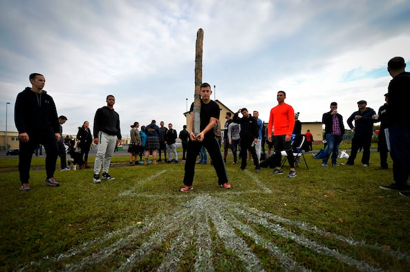 U.S. Air Force Capt. Jose Machuca, 450th Intelligence Squadron intelligence officer, participates in a log toss event during the 693rd Intelligence, Surveillance, and Reconnaissance Group's Highland Games at Wiesbaden, Germany, Oct. 11, 2017. The games featured nine sporting events and were attended by more than 200 people. (U.S. Air Force photo by Airman 1st Class Joshua Magbanua)