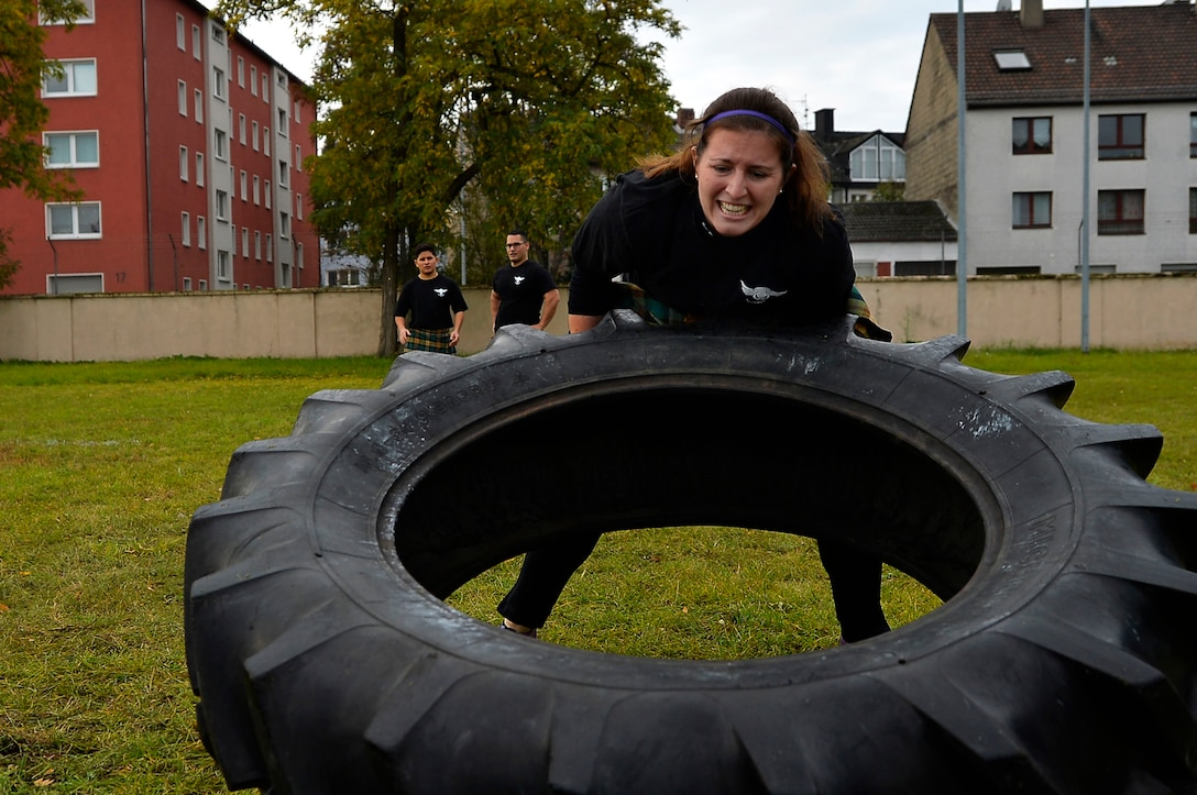 U.S. Air Force 1st Lt. Courtney Sheeks, 450th Intelligence Squadron Central Command analysis team director, participates in a tire flip event during the 693rd Intelligence, Surveillance, and Reconnaissance Group's Highland Games at Wiesbaden, Germany, Oct. 11, 2017. Other sporting events during the games included hammer throw, humvee pull, axe throwing and log toss. (U.S. Air Force photo by Airman 1st Class Joshua Magbanua)