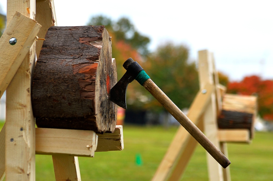 An axe sticks to a block of wood during the axe throwing event of the 693rd Intelligence, Surveillance, and Reconnaissance Group's Highland Games at Wiesbaden, Germany, Oct. 11, 2017. The group's Airmen are scattered in several U.S. military installations in Germany, and converge every year for the games. (U.S. Air Force photo by Airman 1st Class Joshua Magbanua)