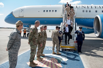 Defense Secretary Jim Mattis and the senior enlisted advisor to the chairman of the Joint Chiefs of Staff, Army Command Sgt. Maj. John Troxell, arrive at MacDill Air Force Base in Tampa, Fla.