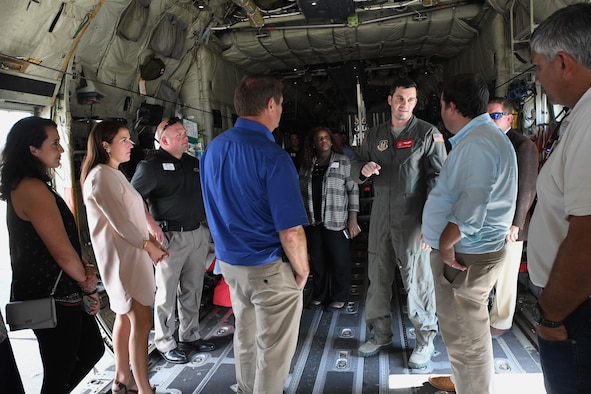 Tech. Sgt. Taylor Noel, 815th Airlift Squadron loadmaster, provides a briefing of C-130 Super Hercules aircraft mission capabilities during the Mississippi Gulf Coast Chamber Leadership Gulf Coast tour Oct. 11, 2017, on Keesler Air Force Base, Mississippi. The program is designed to prepare the areas current and potential leaders for the future with the goal to create a communication network between present and emerging leaders dedicated to the improvement of the Mississippi Gulf Coast by attending a monthly session focused on industry. (U.S. Air Force photo by Kemberly Groue)