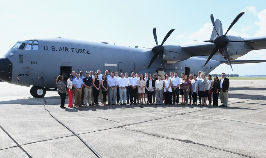 Members of the Mississippi Gulf Coast Chamber Leadership Gulf Coast pose for a group photo in front of a C-130 Super Hercules aircraft during a tour Oct. 11, 2017, on Keesler Air Force Base, Mississippi. The program is designed to prepare the areas current and potential leaders for the future with the goal to create a communication network between present and emerging leaders dedicated to the improvement of the Mississippi Gulf Coast by attending a monthly session focused on industry. (U.S. Air Force photo by Kemberly Groue)