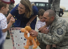 U.S. Air Force Master Sgt. Jeremiah Clarson, 192nd Maintenance Squadron quality assurance inspector, greets his family at Joint Base Langley-Eustis, Va., Oct. 12, 2017.