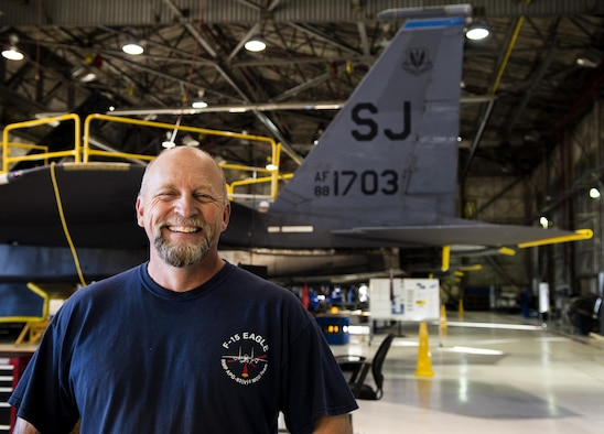 Charlie Loy, Boeing Co. general mechanic, works on F-15E Strike Eagles, installing the radar modifications.