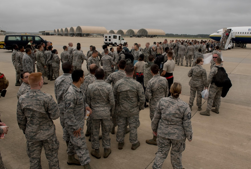 Airmen assigned to the 1st Fighter Wing return home after a 6-month deployment to the Middle East, Oct. 12, 2017. The deployment consisted of F-22 Raptors and Airmen representing the 1st FW in Operation Inherent Resolve against ISIS. (U.S. Air Force photo by Staff Sgt. Carlin Leslie)