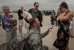 Virginia Air National Guard Staff Sgt. Jeff Greenquist, 192nd Maintenance Squadron low observable technician, proposes to his girlfriend Ashley Branham, after returning from a six-month deployment from the Middle East with the 1st Fighter Wing at Joint Base Langley-Eustis, Va., Oct. 12, 2017. The deployment consisted of F-22 Raptors and Airmen representing the 1st FW in Operation Inherent Resolve against ISIS. (U.S. Air Force photo by Staff Sgt. Carlin Leslie)