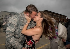 Virginia Air National Guard Staff Sgt. Jeff Greenquist,  192nd Maintenance Squadron low observable technician, kisses his fiancé  Ashley Branham, after she accepted his proposal to marry her at Joint Base Langley-Eustis, Va., Oct. 12, 2017. Greenquist just returned from a six-month deployment to the Middle East with the 1st Fighter Wing. (U.S. Air Force photo by Staff Sgt. Carlin Leslie)