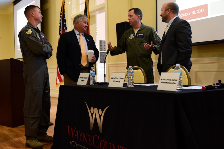 Col. Christopher Sage, 4th Fighter Wing commander, center, discusses the State of the Military with, pictured from left, Col. Scovill Currin, 916th Air Refueling Wing commander; Chuck Allen, City of Goldsboro Mayor; and Dr. Scott LaFevers, Wayne County Military Affairs Committee chairman, Oct. 10, 2017, at the Goldsboro Event Center in Goldsboro, North Carolina.