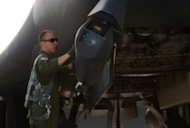 1st Lt. Thomas, a weapon systems officer assigned to the 34th Bomb Squadron, inspects the sniper pod on a B-1 bomber before take-off as part of exercise Combat Raider 18-1 at Ellsworth Air Force Base, S.D., Oct. 11, 2017. This exercise introduces aircrew to various air-to-air and air-to-ground scenarios to ensure they are well prepared for future combat missions. (U.S. Air Force photo by Airman 1st Class Donald C. Knechtel)