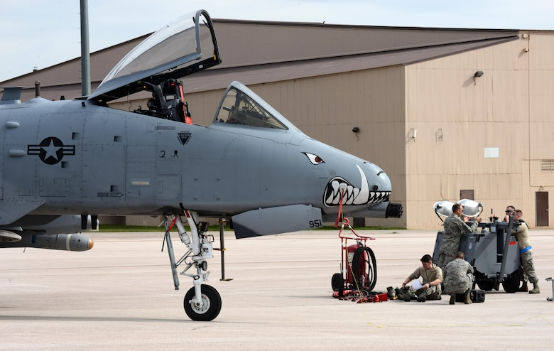 Maintainers prepare an Air Force Reserve A-10 Thunderbolt II fighter from Kansas City, Mo., for exercise Combat Raider 18-1 at Ellsworth Air Force Base, S.D., Oct. 11, 2017. Combat Raider integrates the A-10 Thunderbolt II with the B-1 bomber and helps aviators integrate as one joint unit, allowing more complex training that simulates a more realistic combat deployment. (U.S. Air Force photo by Airman 1st Class Donald C. Knechtel)