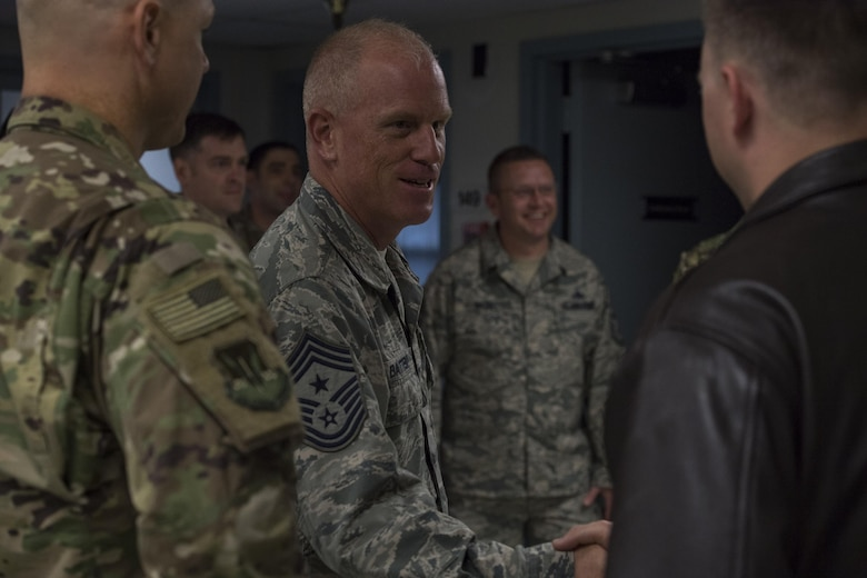 Chief Master Sergeant Frank H. Batten III, command chief of Air Combat Command, greets Airmen during his visit to the 20th Air Support Operations Squadron, Oct. 9, 2017, at Fort Drum, N.Y. Batten visited Airmen belonging to the 14th, 20th and 682d ASOS, and 18th Weather Squadron Detachment 1 during Warfighters Exercise 18-1, to observe Airmen fully engaged in roles they would fill for the Army while downrange. (U.S. Air Force photo by Senior Airman Janiqua P. Robinson)