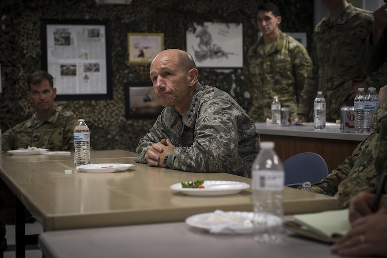 Gen. Mike Holmes, commander of Air Combat Command, center, listens to questions over lunch during his visit to the 20th Air Support Operations Squadron, Oct. 9, 2017, at Fort Drum, N.Y. Holmes visited Airmen belonging to the 14th, 20th and 682d ASOS, and 18th Weather Squadron Detachment 1 during Warfighters Exercise 18-1, to observe Airmen fully engaged in roles they would fill for the Army while downrange. (U.S. Air Force photo by Senior Airman Janiqua P. Robinson)