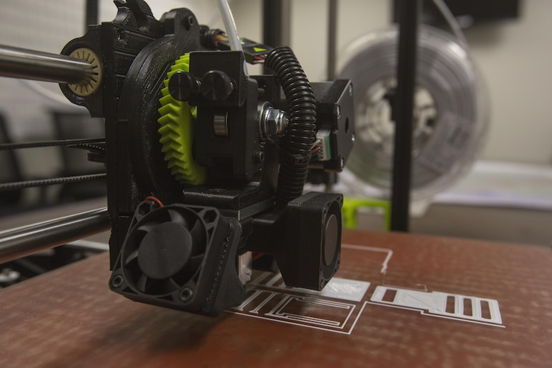 The 3-D printer from 2nd Battalion, 8th Marine Regiment begins to form the base layer of pack clips at Camp Lejeune, N.C., Oct. 6, 2017. 2/8 is the first infantry battalion in the United States Marine Corps to utilize a 3-D printer to ensure battalion readiness in the event of equipment malfunctions. (U.S. Marine Corps photo by Lance Cpl. Ashley McLaughlin)