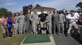 Anthony Netto, center, Stand Up and Play Foundation founder, poses for a photo with golf demonstration participants at Joint Base Andrews, Md., Oct. 6, 2017. The demonstration was part of National Disability Employment Awareness Month, a time set aside in the U.S. to affirm and recognize the many contributions of American workers with disabilities.