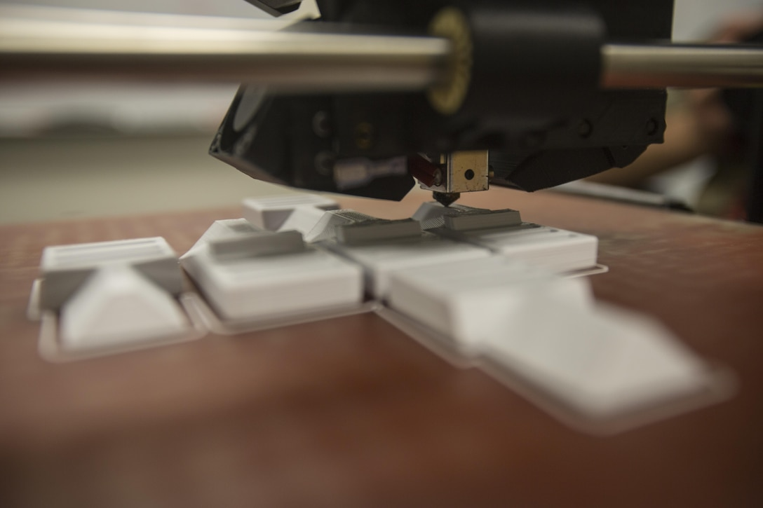 The 3-D printer from 2nd Battalion, 8th Marine Regiment prints pack clips at Camp Lejeune, N.C., Oct. 6, 2017. 2/8 is the first infantry battalion in the United States Marine Corps to utilize a 3-D printer to ensure battalion readiness in the event of equipment malfunctions. (U.S. Marine Corps photo by Lance Cpl. Ashley McLaughlin)