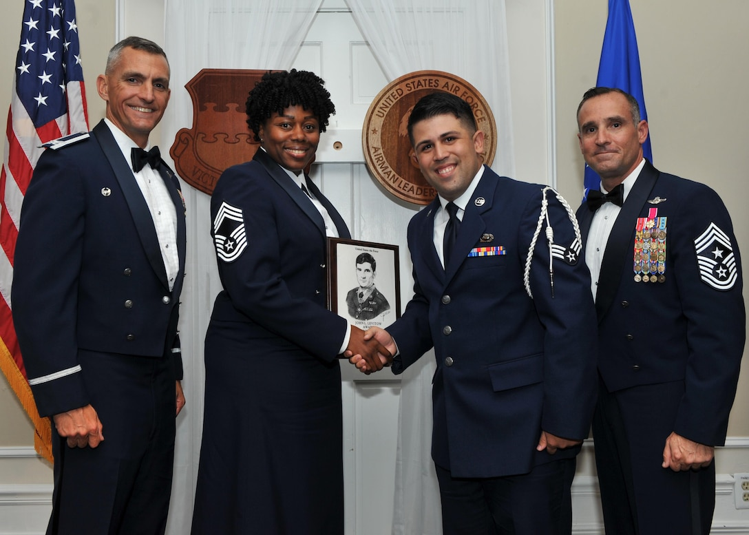 U.S. Air Force Senior Airman Daniel Aviles, 3rd Intelligence Squadron, receives the John L. Levitow Award for class 17-7 of the Senior Master Sgt. David B. Reid Airman Leadership School from Chief Master Sgt. Lisa Rogers, the class' senior advisor, at Shaw Air Force Base, S.C., Oct. 6, 2017.