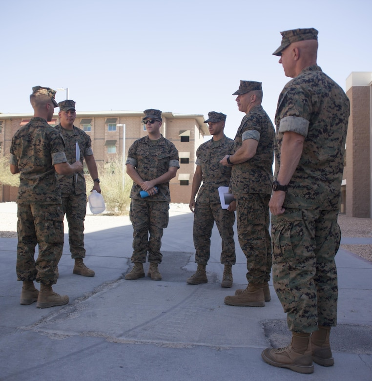 1st Lt Ryan Petty, officer in charge of the Remain Behind Unit, 7th Marine Regiment, explains the renovations made at barracks 1404 aboard the Combat Center, Oct.  5, 2017. Marines with 7th Marines and Public Works Division personnel renovated rooms and lounges for the purpose of providing improved living quarters for the deployed Marines of the regiment.  (U.S. Marine Corps photo by Cpl. Natalia Cuevas)